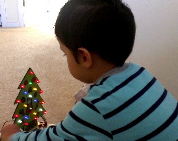My son (Rey) playing with his new Christmas toy