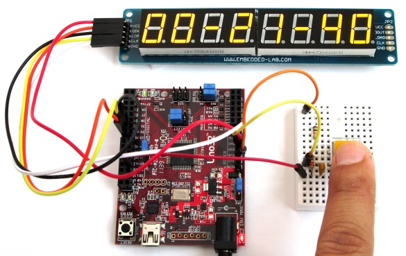 Digital stopwatch displays time on seven segment LEDs