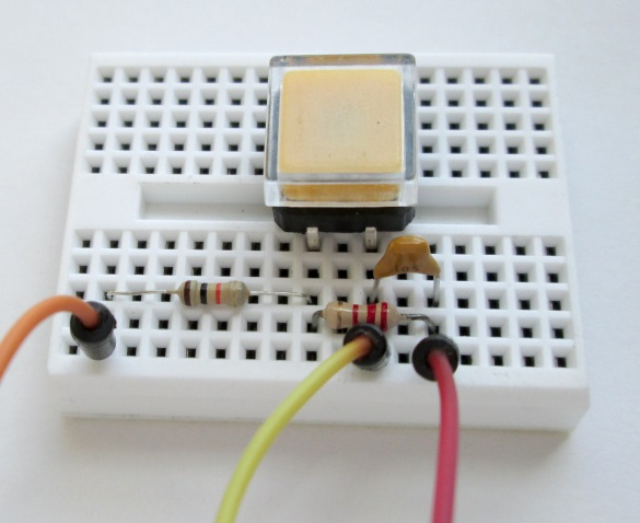 Push switch with debouncing circuit on breadboard