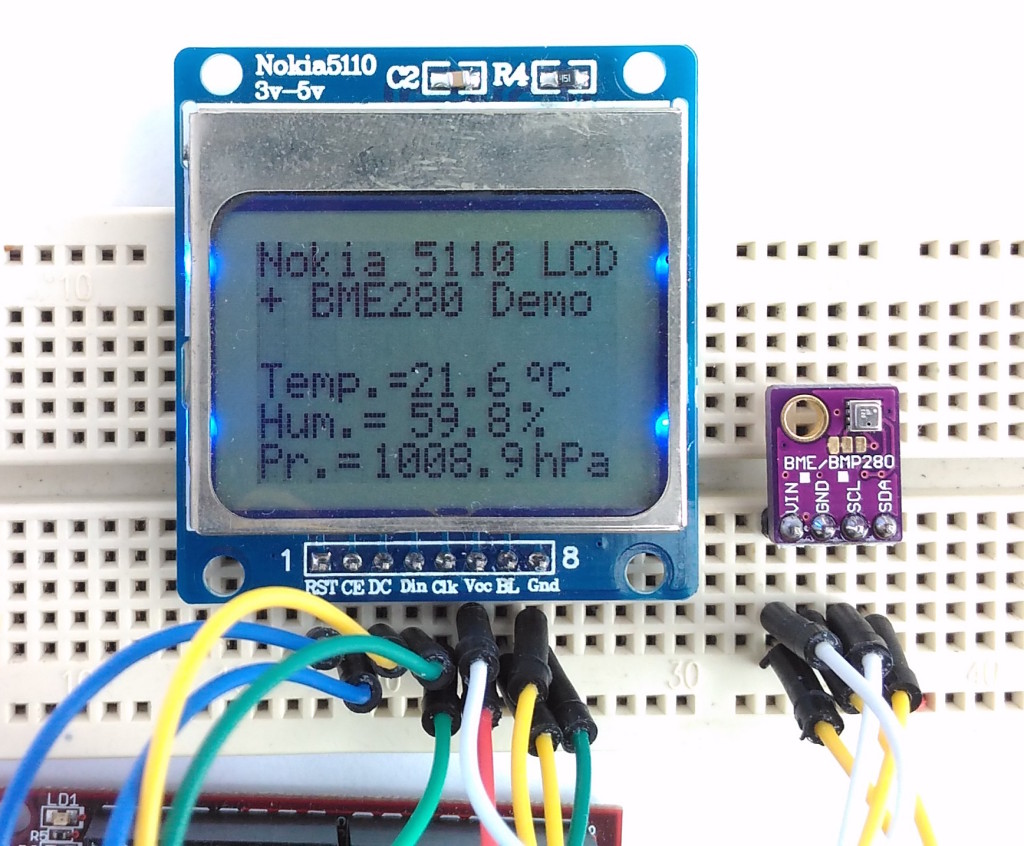 Weather station displaying temperature, humidity, and pressure.