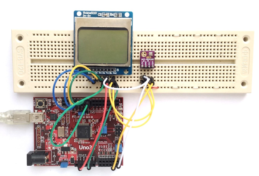 The actual setup of the project. The Nokia5110 LCD and BME280 sensor modules are laid out on a breadboard.
